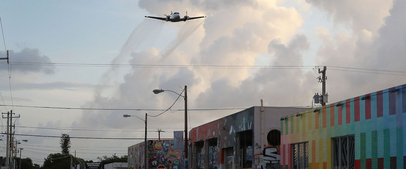 PHOTO:A plane sprays pesticide over the Wynwood neighborhood of Miami, FL in the hope of controlling and reducing the number of mosquitos, some of which may be capable of spreading the Zika virus on August 6, 2016.