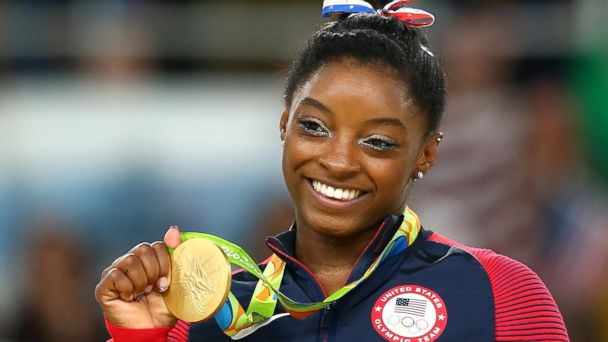 PHOTO: Gold medalist Simone Biles of the United States celebrates on the podium at the medal ceremony for the Women's Floor on Day 11 of the Rio 2016 Olympic Games on Aug. 16, 2016 in Rio de Janeiro.