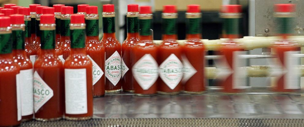 """PHOTO: Dozens of health workers in Texas are using Tabasco sauce to help drill for the next Ebola patient. If they get the tingly sauce on their skin during training, theyve been """"contaminated."""" Bottles of Tabasco sauce are seen here in this file photo."""