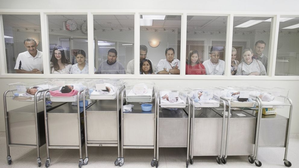 PHOTO: New parents watch their babies in the hospital nursery.