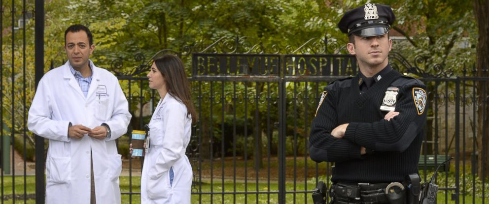 PHOTO: A police officer guards the entrance to Bellevue Hospital on Oct. 24, 2014 in New York City.