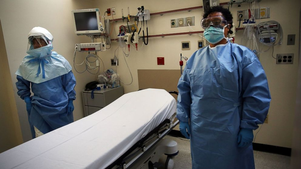 PHOTO: Members of Bellevue Hospital staff wear protective clothing as they demonstrate how they would receive a suspected Ebola patient on Oct. 8, 2014 in New York City.