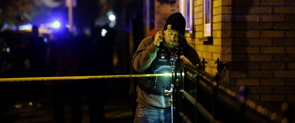 PHOTO: A Chicago Police officer uses a flashlight as he investigates a crime scene where a man was shot in the head as he sat in a vehicle on the 2600 block of West Luther Street, Nov. 16, 2016, in Chicago.