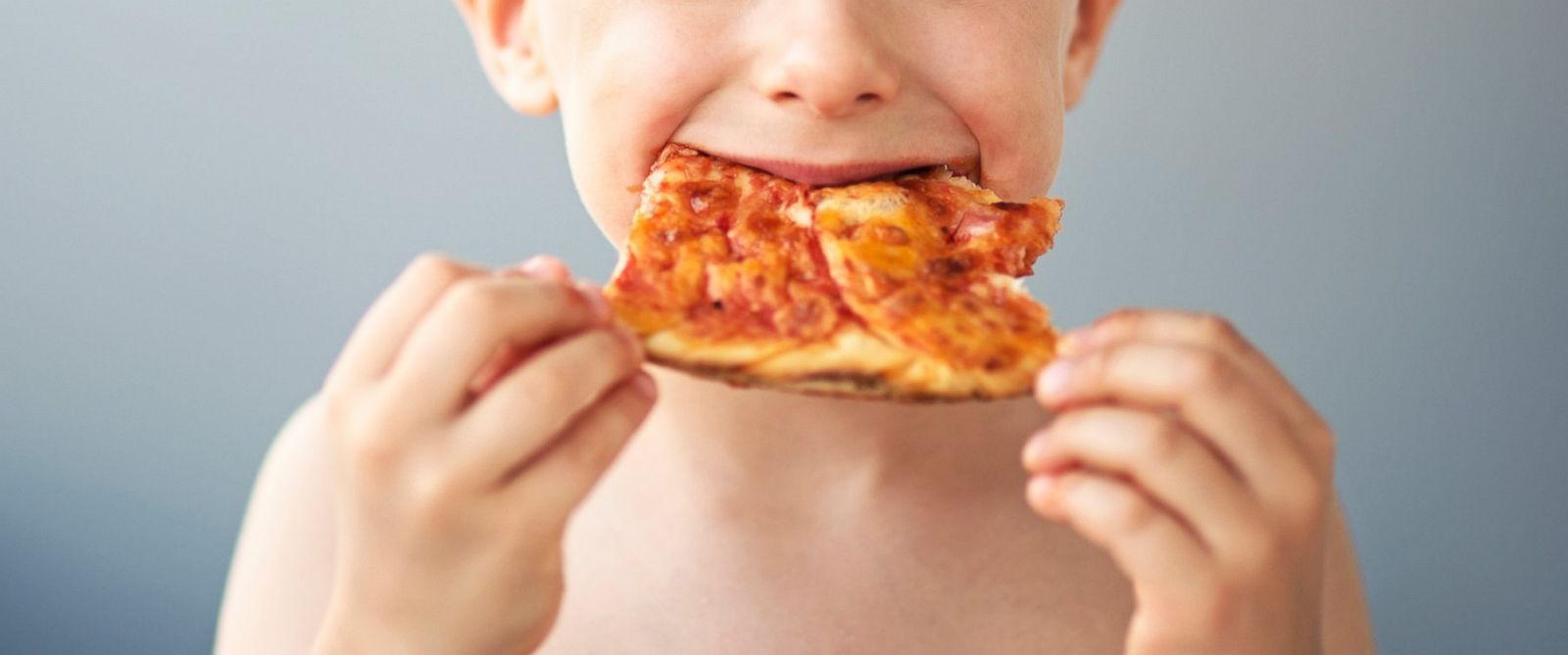 PHOTO: A boy eats pizza in this undated stock photo.