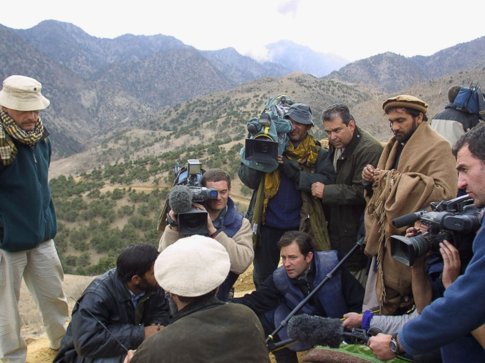 PHOTO: Dan Harris, amongst other journalists, is pictured questioning Hazrat Ali on Dec. 14, 2001 in the Tora Bora region of Afghanistan.