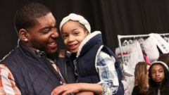PHOTO: NFL player Devon Still, left, and daughter, prepare backstage at the Nike Levis Kids fashion show during Mercedes-Benz Fashion Week Fall 2015 at The Salon at Lincoln Center, Feb. 12, 2015, in New York.