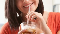 PHOTO: A woman is pictured drinking soda in this stock image.