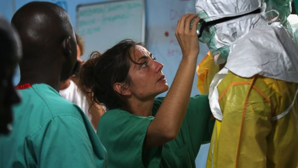 PHOTO: A staffer for Doctors Without Borders suits up in protective clothing