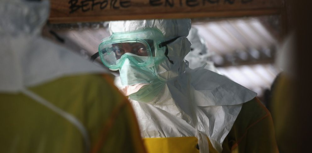 PHOTO: A staffer for Doctors Without Borders suits up in protective clothing before entering a high-risk area of the MSF Ebola treatment center on Aug. 21, 2014 near Monrovia, Liberia.