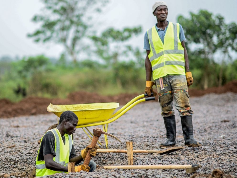 PHOTO: A worker from the International Committee of the Red Cross digs a hole with a pickaxe during the construction a brand new health center in Kenema, Sierra Leone on Aug. 25, 2014.