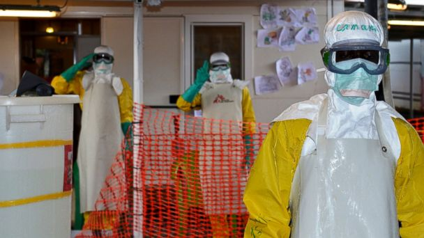 PHOTO: Health workers wearing protective gear gesture at the Nongo ebola treatment centre in Conakry, Guinea, Aug. 21, 2015.