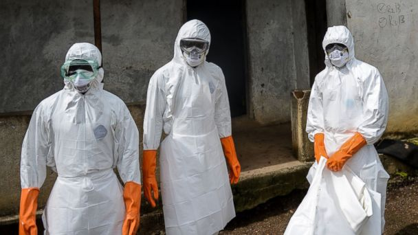 PHOTO: A group of young volunteers wear special uniforms and sterilize around a house after Baindu Koruma, 28, died due to the Ebola virus in Lango village, Kenema, Sierra Leone on Aug. 25, 2014.