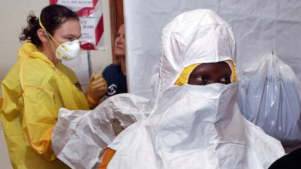 PHOTO: Staff of the Christian charity Samaritans Purse is pictured putting on protective gear in the ELWA hospital in Monrovia, Liberia on July 24, 2014.