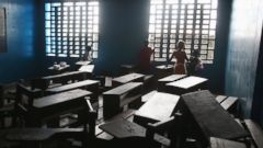 PHOTO: Children look out from a newly-opened Ebola isolation center set up in a school