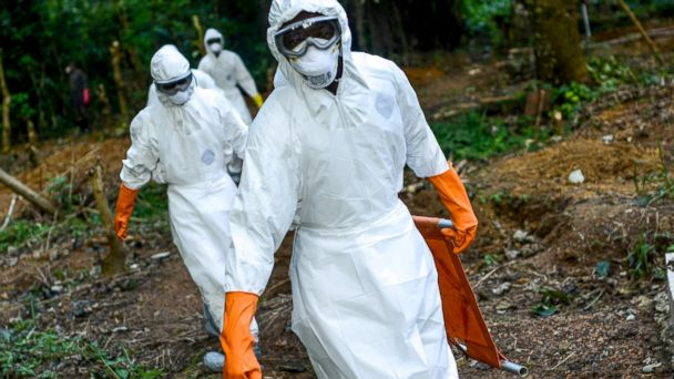 PHOTO: Members of a volunteer medical team wear special uniforms for the burial of people, sterilized after dying due to the Ebola virus, in Kenema, Sierra Leone, Aug. 26, 2014.