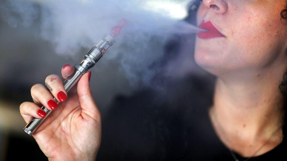PHOTO: Julia Boyle enjoys an electronic cigaret