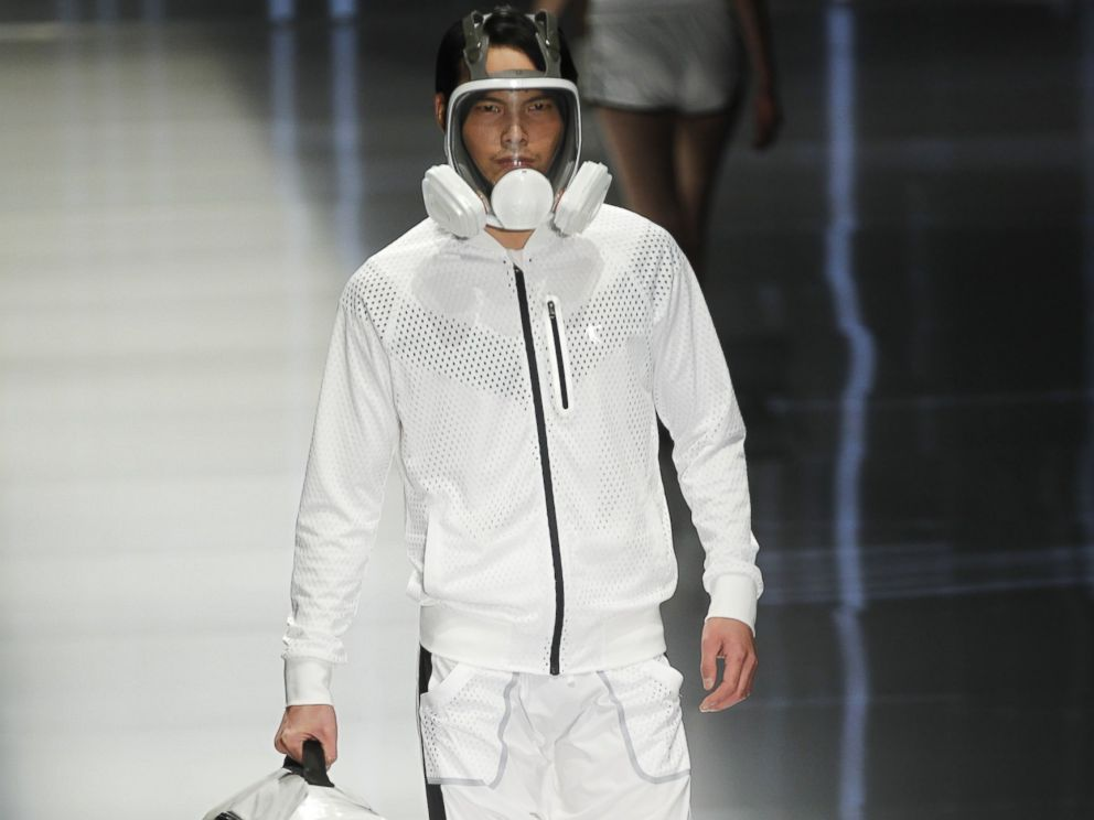 PHOTO: Pollution-blocking masks became the latest fashion statement on the runway at Fashion Week in Beijing, Oct. 28, 2014.