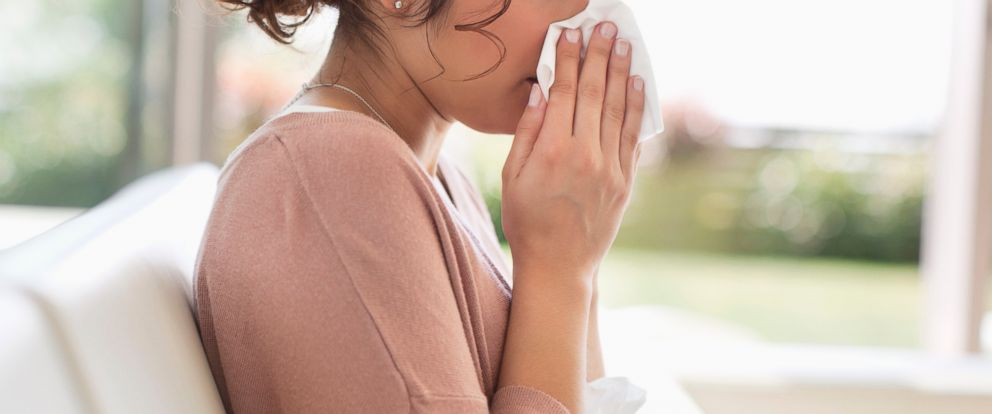 PHOTO: A sick woman is pictured blowing her nose in this stock photo.