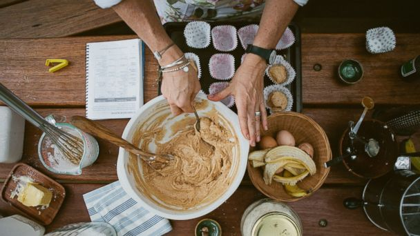 PHOTO: A baker mixes ingredients for gluten-free banana muffins.