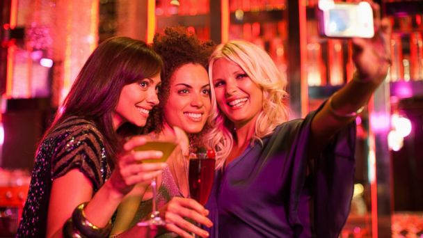 PHOTO: In this stock photo, friends are pictured at a nightclub taking a self-portrait.