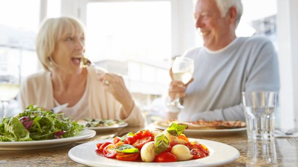 PHOTO: In this stock image, a couple is pictured eating healthier food options.