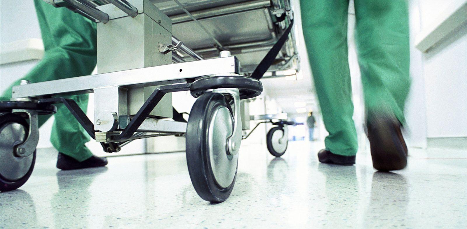 PHOTO: Gurney being rushed through hospital corridor.