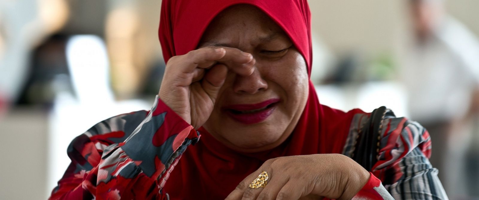 PHOTO: A relative of a passenger onboard missing Malaysia Airlines flight MH370 cries in Putrajaya, Malaysia on March 12, 2014.