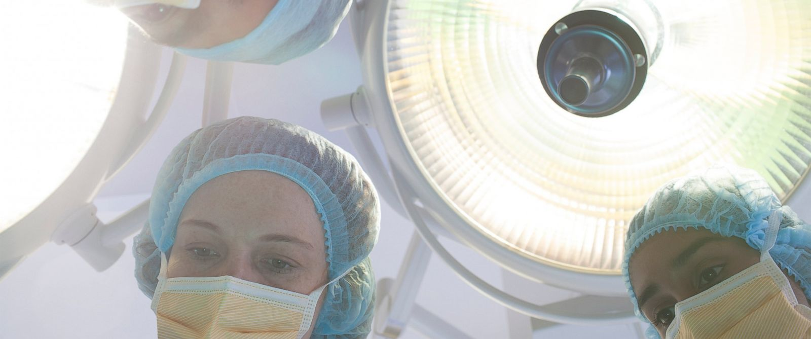PHOTO: Lights above on operating table.