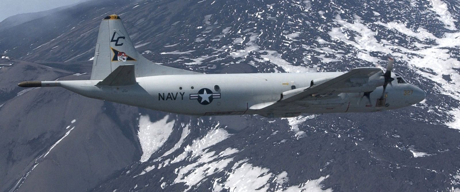 """PHOTO: A P-3C Orion aircraft assigned to the """"Tigers"""" of Patrol Squadron Eight (VP-8) flies over Mt. Etna, May 26, 2003."""