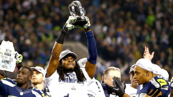 PHOTO: Richard Sherman of the Seattle Seahawks celebrates with the George Halas Trophy after the Seahawks defeated the San Francisco 49ers 23-17 in the 2014 NFC Championship at CenturyLink Field in Seattle, Jan. 19, 2014.