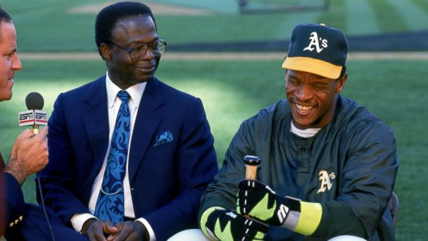 PHOTO: Lou Brock and Rickey Henderson of the Oakland Athletics are interviewed before the game against the New York Yankees at the Oakland-Alameda County Coliseum in Oakland, Calif., April 30, 1991.