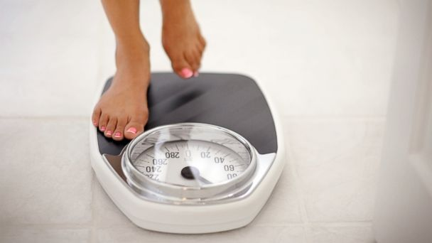 PHOTO: In this undated stock image, a woman is pictured stepping on a scale.