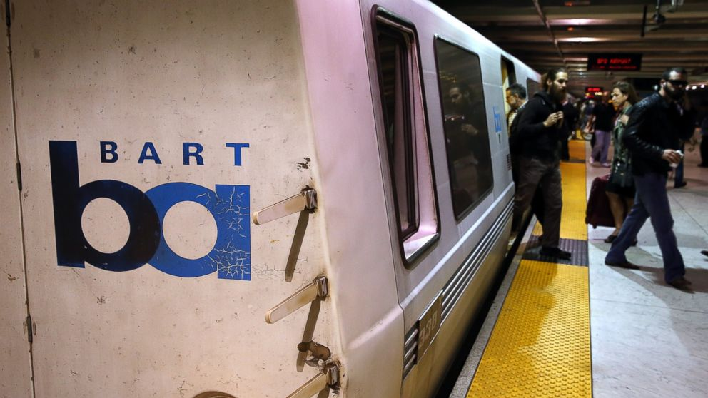 PHOTO: Bay Area Rapid Transit (BART) passengers walk off of a train on October 15, 2013, San F