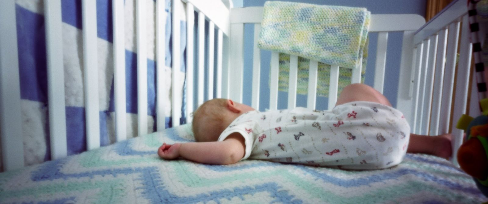 PHOTO: A baby sleeps in a crib.