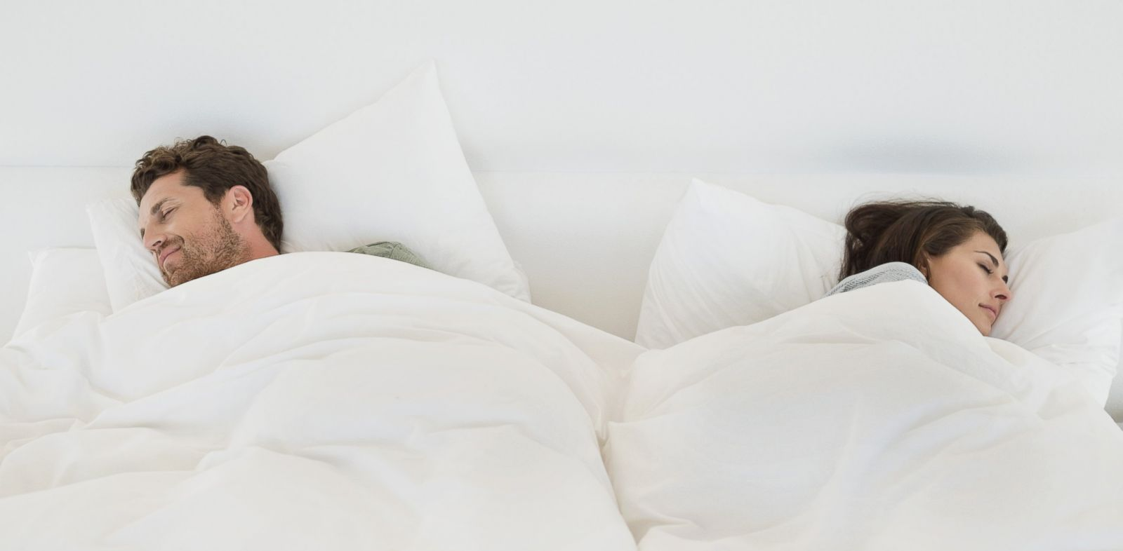 PHOTO: In this stock image, a couple is pictured sleeping in bed.