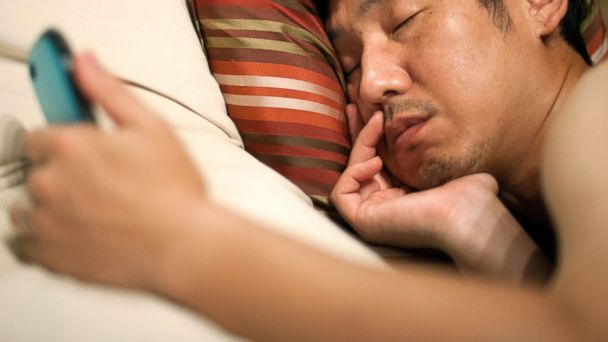 PHOTO: Here are some reasons why not to fall asleep with your smartphone in bed.
