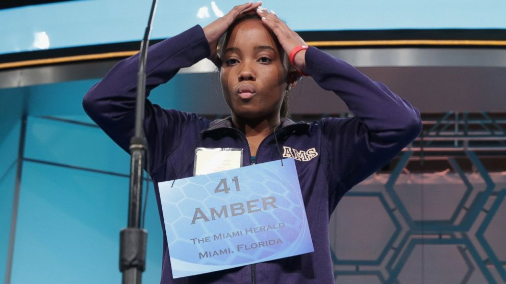 PHOTO: Speller Amber Robinson of Homestead, Florida, reacts as she participates during round three of the 2014 Scripps National Spelling Bee competition, May 28, 2014 in National Harbor, Md.