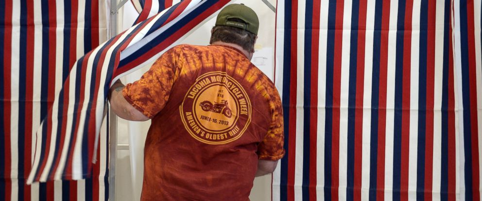 PHOTO: A voter enters the voting booth at the Bishop Leo E. ONeil Youth Center on Nov. 4, 2014 in Manchester, N.H.