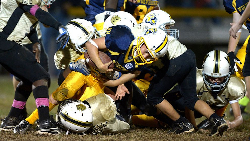 PHOTO: Pee Wee Wolverine running back Kosta Berns in a tackle during a game in Rockville, Sept. 28, 2012.
