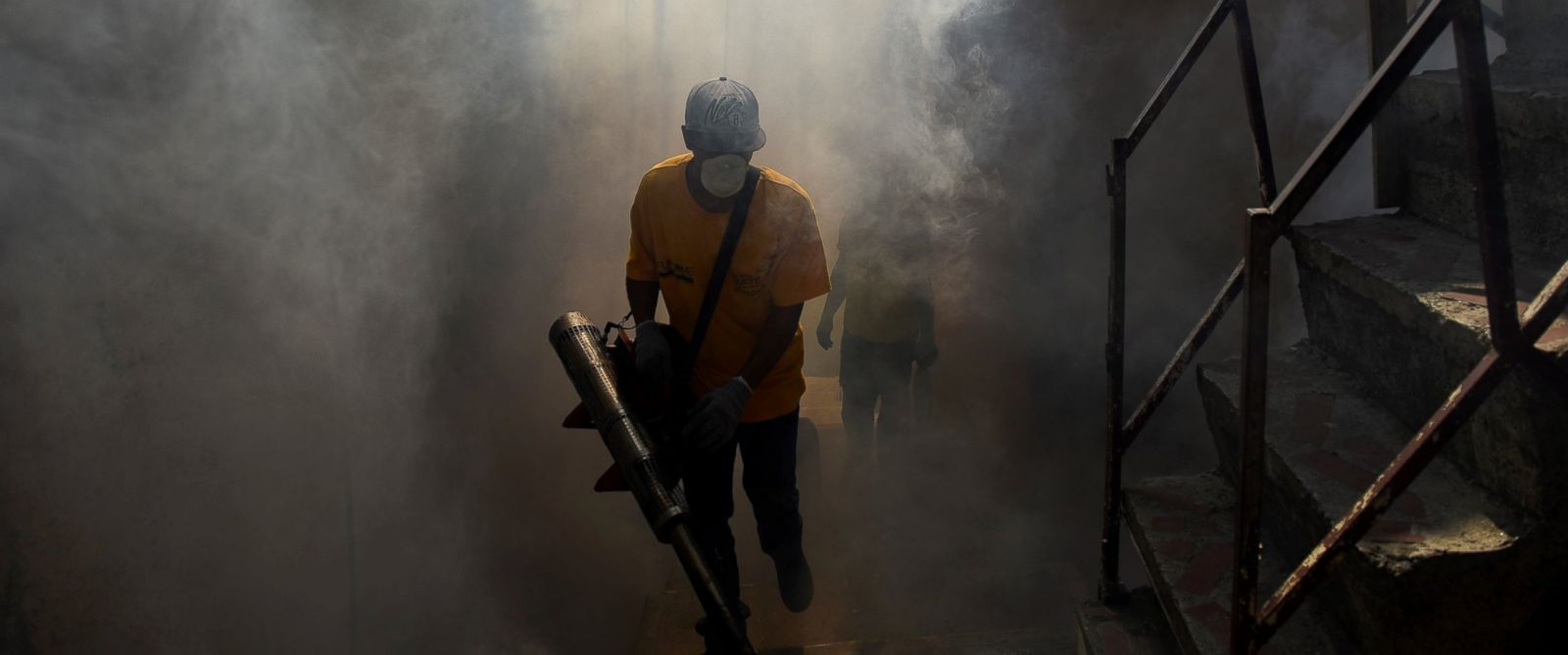 PHOTO: A Health employee fumigates against Aedes Aegypti mosquito in an alley in Petare,Venezuela, Feb. 3, 2016.