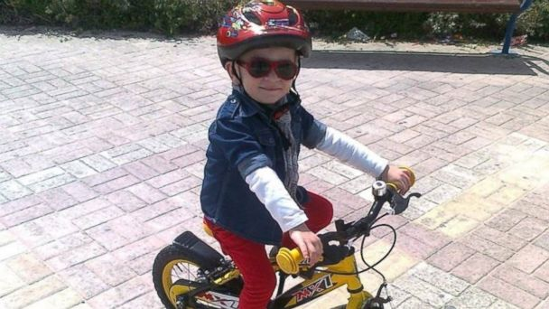 PHOTO: Boy with life-threatening illness takes on triathlons to stay healthy.