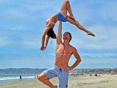PHOTO: Cheetah Platt and Rhiann Woodyard, both acrobats, are traveling through 12 countries to celebrate their wedding with 20 ceremonies.