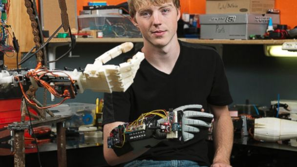 PHOTO: Easton LaChappelle poses with an earlier version of his robotic arm.