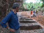 PHOTO: Dr. Besser looks on as workers dig graves outside an Ebola clinic in Liberia.
