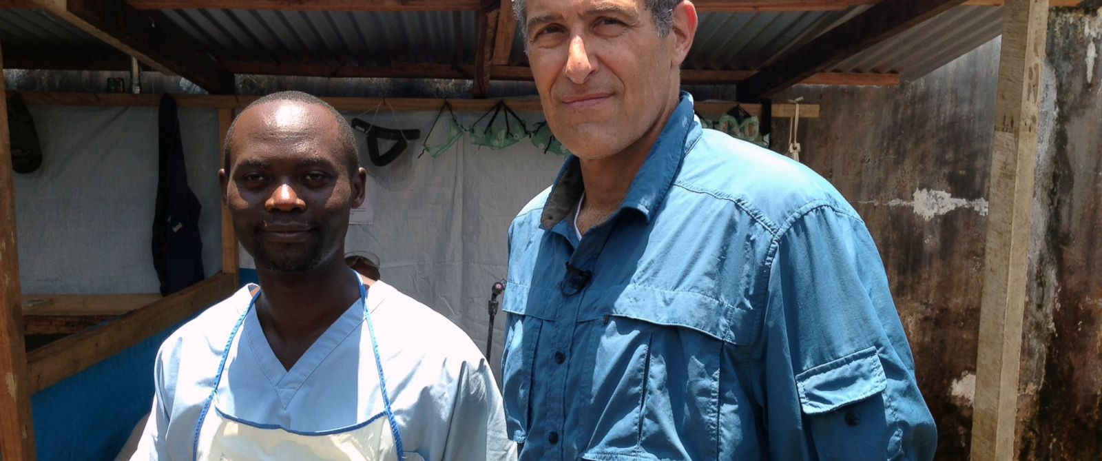 PHOTO: Dr. David Kaggwa and Dr. Richard Besser at an Ebola ward in Monrovia, Liberia.