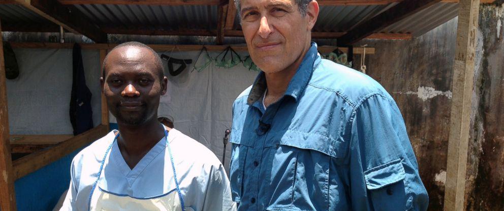 PHOTO: Dr. David Kaggwa and Dr. Richard Besser at an Ebola ward in Monrovia, Liberia.