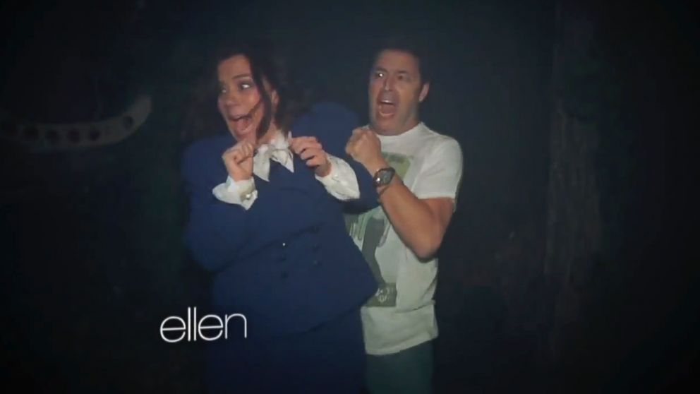PHOTO: Amy Rhodes and Andy Lassner navigate a haunted house at Universal Studios Horror Nights.