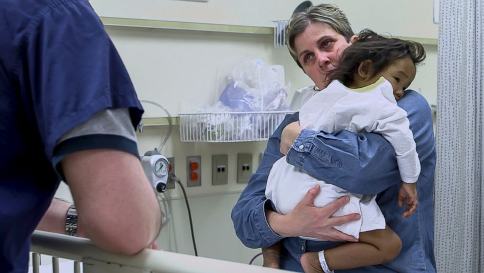 PHOTO: Johanne Wagner cares for her daughter Phuoc just before she undergoes a liver transplant