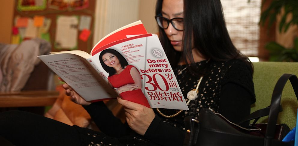 "PHOTO: A woman reads ""Do Not Marry Before Age 30"" by Joy Chen."