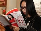 PHOTO: A woman reads Do Not Marry Before Age 30 by Joy Chen.